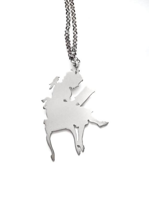 young reader and parrot silver charm