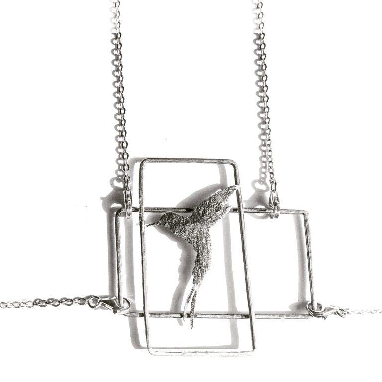 a mezz'aria silver hummingbird body necklace