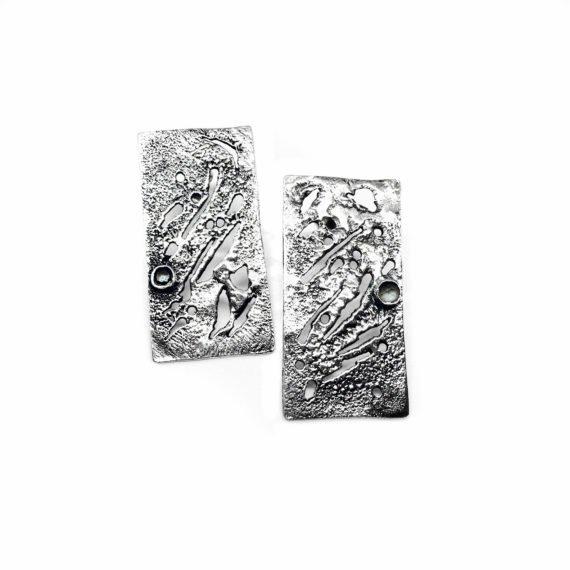 silver skin earrings contrast