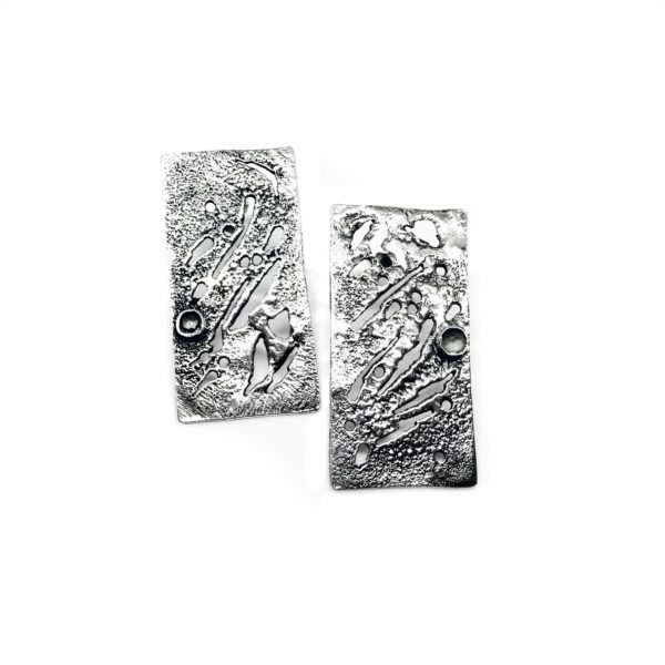 silver skin earrings contrast
